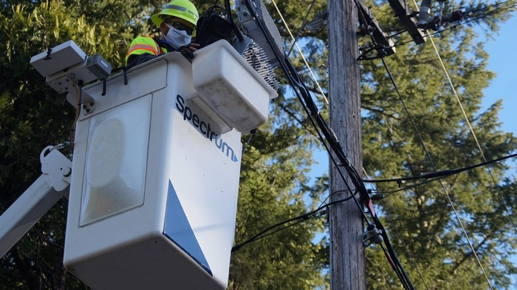 Worker fixing telephone pole
